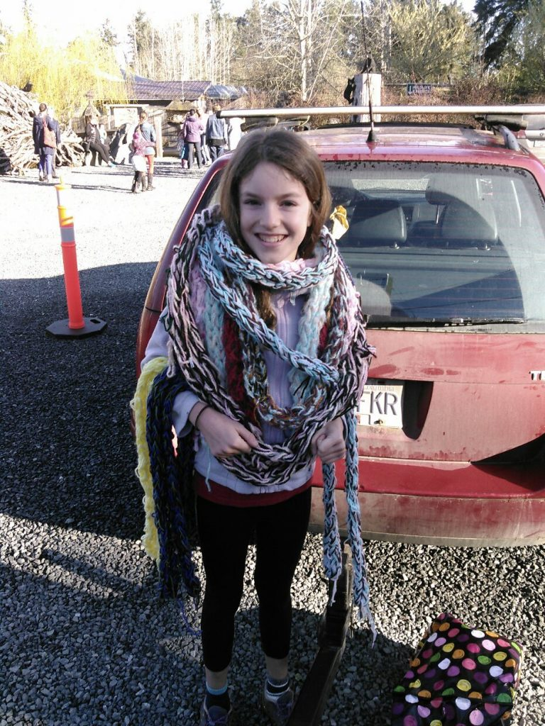 Young girl knitted scarves for the homeless